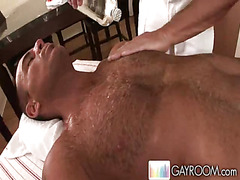 Muscled man gets hot massage