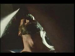 Bearded bottom in retro gay video