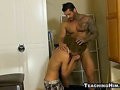 Twink sucking on a mature studs rock hard cock