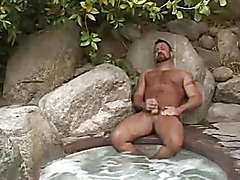 Bear masturbates in hot tub