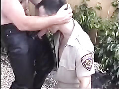 Cop sucks on leather penis