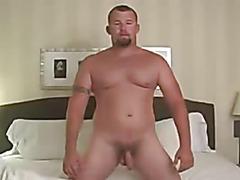 Chubby guy strokes solo