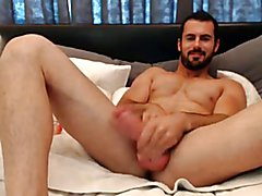 Guy plays with his semen after fucking off his enormous prick