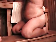one bear, one men in sauna