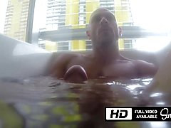 Johnny sins playing with his massive cock in the bathtub