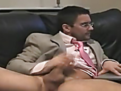 Business man beats off to porn