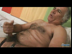 Oldie haired guy masturbates